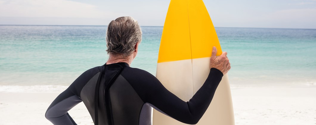 Higos Man holding surfboard on the beach Personal insurance